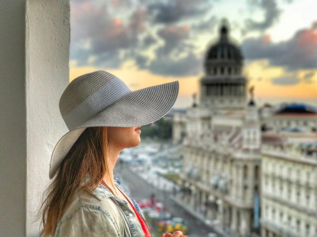 woman overlooking Havana at sunset