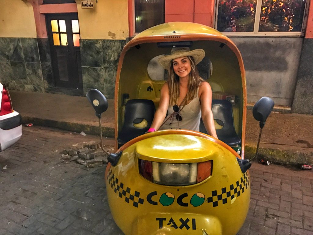 woman in coco taxi in Havana