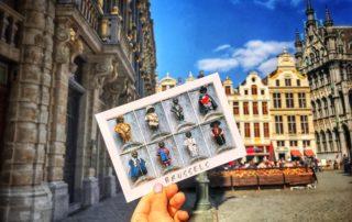 postcard of manneken pis in variety of costumes