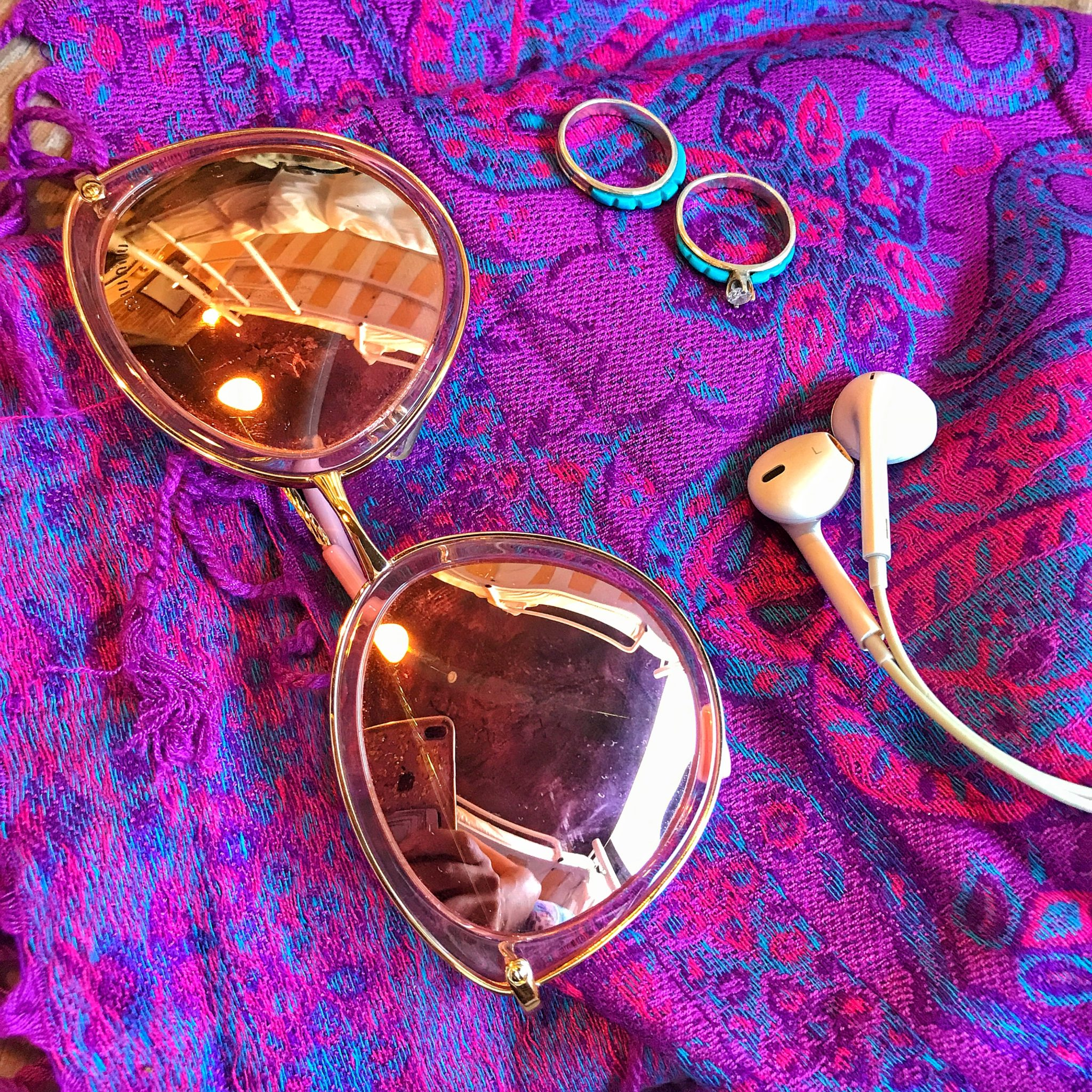 Sunglasses and earbuds